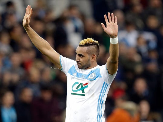 FILE - In this Tuesday, Jan.31, 2017 file photo, Marseille's forward Dimitri Payet celebrates at the end of the French Cup soccer match between Marseille and Lyon, at the Velodrome Stadium, in Marseille, southern France. Dimitri Payet left the glamor of the Premier League for this kind of match: 67,000 home fans screaming their support against their hated rival. The night of Sunday, Feb. 26 sees the French league's biggest and bitterest rivalry as Marseille takes on visiting Paris Saint-Germain, the defending champion. (AP Photo/Claude Paris, file)