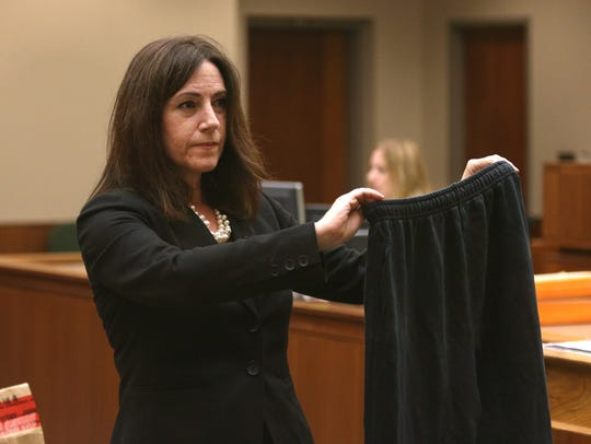 Julie Cianca, attorney for Alexander Rideout, holds
