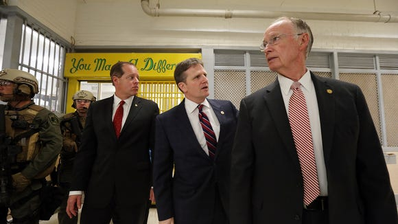 Alabama Gov. Robert Bentley, right, tours a portion of William C. Holman Correctional facility in Atmore, Ala., Tuesday, March 15, 2016 with Alabama Department of Correctional Commissioner Jeff Dun, center, and state Sen. Cam Ward.