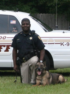 Victor and handler Cpl. Marcus Green