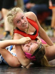Sweet Home's Marissa Kurtz, bottom, and Thurston's Macie Stewart wrestle in an exhibition round during the girls freestyle/Greco state wrestling tournament on Saturday, April 23, 2016, at Crescent Valley High School in Corvallis, Ore.