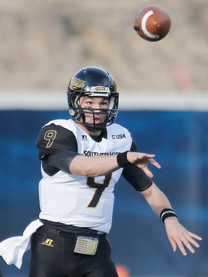 Southern Miss quarterback Nick Mullens passes against Rice during Saturday's game in Houston, Texas. Mullens threw for 386 yards and five touchdowns in the Golden Eagles' 65-10 victory over the Owls.
