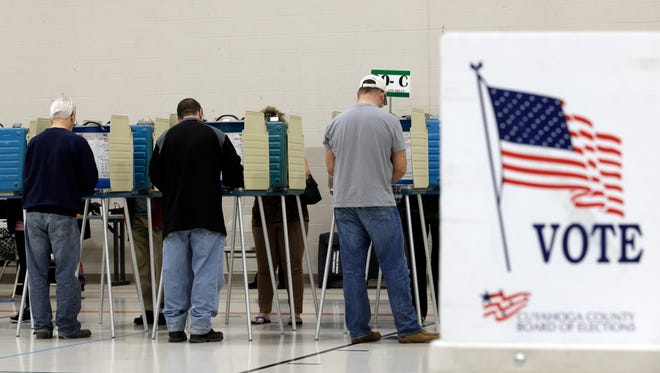 Voters cast their vote at the athletic wing of Orange High School Tuesday, Nov. 3, 2015, in Moreland Hills, Ohio. Voters overwhelmingly approved redistricting reform. (AP Photo/Tony Dejak)