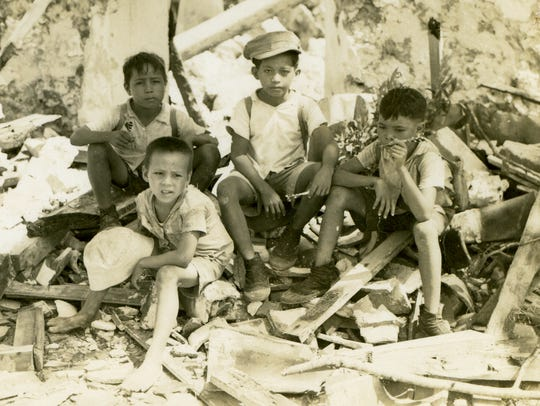A photo from Talofofo resident Irene Perez Ploke Sgambelluri-Beruan's collection of postwar images shows young children amid rubble.