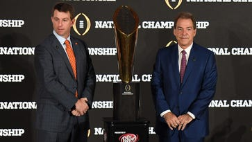 Jan 8, 2017; Tampa, FL, USA; Clemson Tigers head coach Dabo Swinney and Alabama Crimson Tide head coach Nick Saban pose for photos with the trophy during the head coaches news conference at the Tampa Convention Center. Mandatory Credit: John David Mercer-USA TODAY Sports