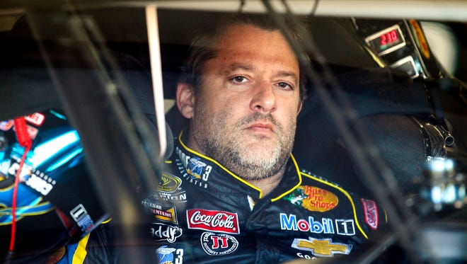 Driver Tony Stewart sits in his car during practice for the NASCAR Sprint Cup auto race at New Hampshire Motor Speedway, Friday, Sept. 19, 2014, Loudon, N.H. (AP Photo/Cheryl Senter)