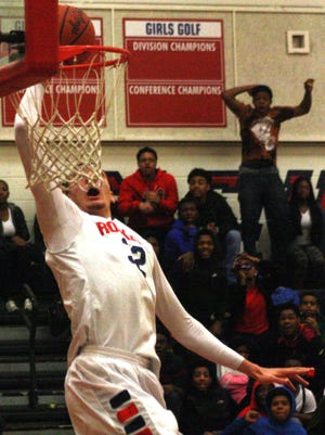 This second-half dunk by Westland John Glenn's Mike Edwards left one fan (upper-right) in disbelief.