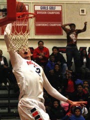 Mike Edwards throws down a dunk during the Rockets'