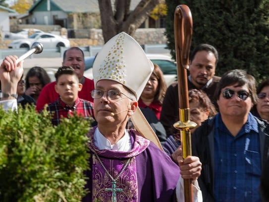 Bishop Mark J. Seitz blessing the new center.