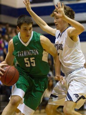 Farmington's David Riley dribbles past Piedra Vista's Jason Compton on Tuesday at Scorpion Gym in Farmington.