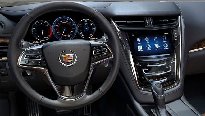 Cadillac CTS CUE infotainment setup, displayed on screen, makes even turning up the radio difficult, Consumer Reports says, hobbling the scores of an other wise excellent car.