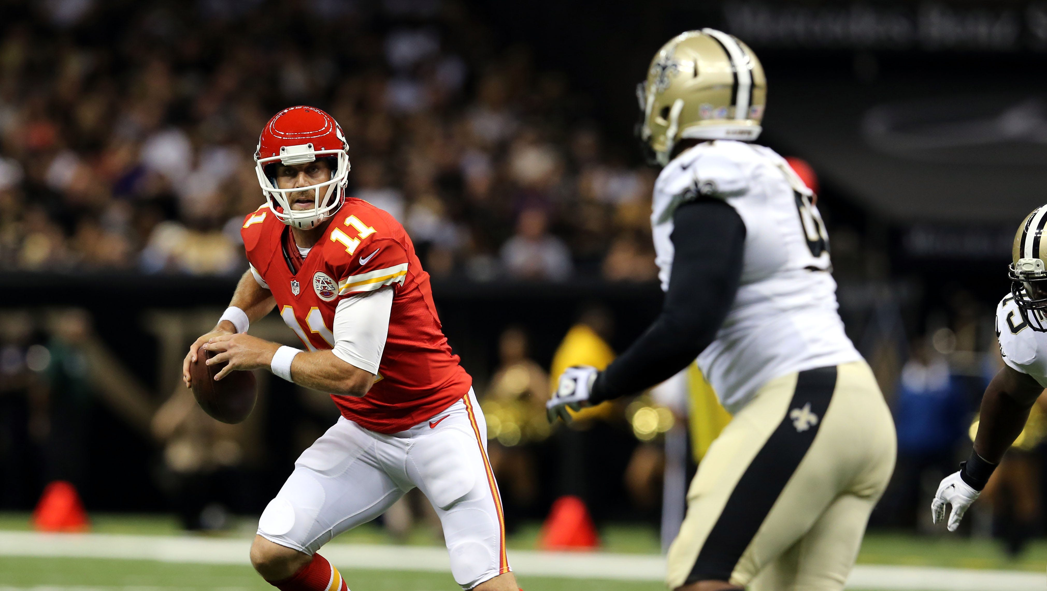 Kansas City Chiefs quarterback Alex Smith (11) rolls out while pressured by New Orleans Saints defensive end Cameron Jordan (94).