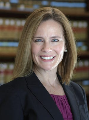 This 2017 photo provided by the University of Notre Dame Law School in South Bend, Ind., shows Judge Amy Coney Barrett. Barrett is President Donald Trump's nominee to replace Supreme Court Justice Ruth Bader Ginsburg.