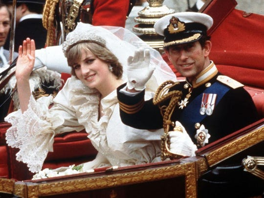 Charles and Diana wave from their carriage on their