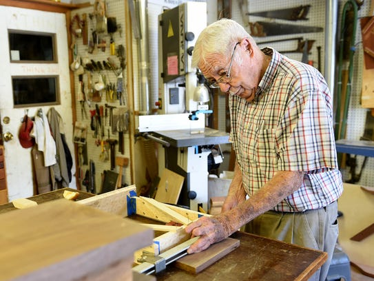 Al Hudson, 97, works in his wood shop at his home in