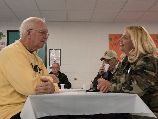 Veterans Fred Machon and Andrea Bohannon talk before