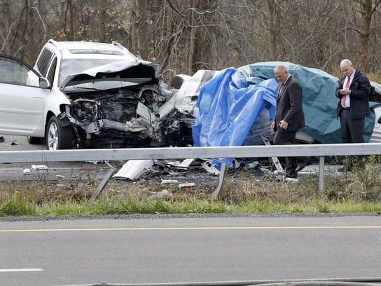 In a Nov. 2 photo, police investigate the crash site