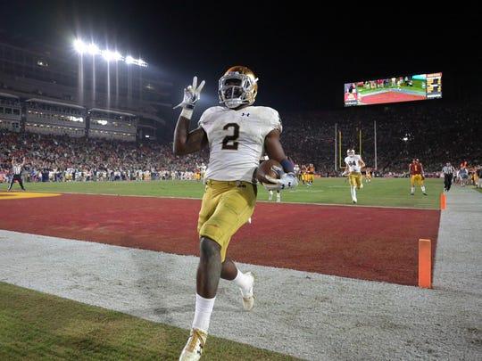 Dexter Williams celebrates a touchdown against USC in 2018.