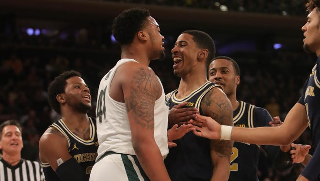 Face-to-face: MSU's Nick Ward and Michigan's Charles Matthews politely converse during the first half Saturday in the Big Ten tournament. U-M got the last laugh.