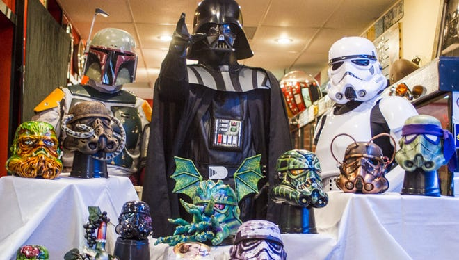 """More than 60 U.S. artists painted stormtrooper helmets for the Ink Empire Tattoo Expo's """"Helmet Wars"""" exhibit. Darth Vader approves."""