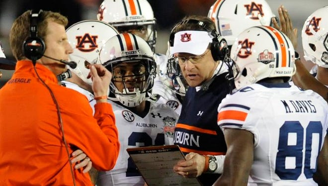 Auburn coach Gus Malzahn works with his players in first half action of the BCS National Championship Game on Monday January 6, 2014 in Pasadena, Ca.