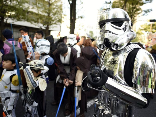 A participant in a Star Wars costume poses before the