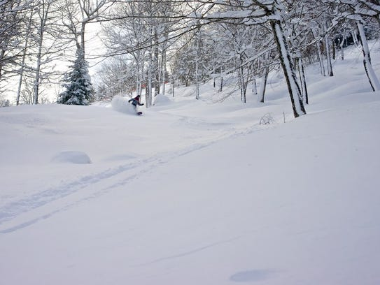 Folks ski on Smugglers Notch side country this weekend.