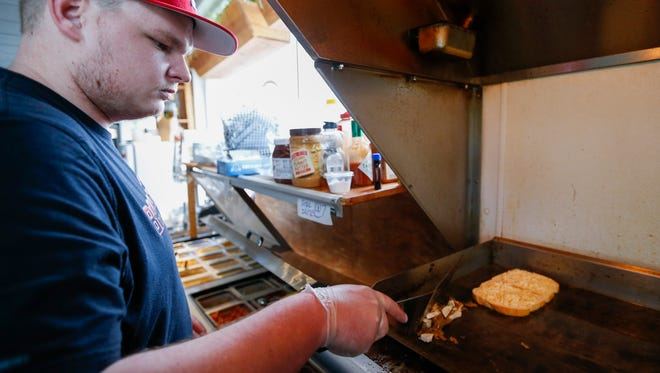 Druffs, the downtown Springfield grilled-cheese restaurant, is one of the early adopters of online food-ordering service Grubhub, which added delivery service Monday. Brett Kilian makes a Sullipants sandwich at Druff's on Thursday, March 29, 2018.