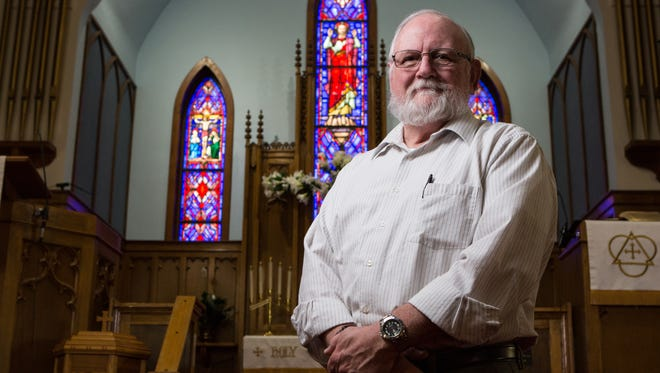 Travis DeLoach, pastor of Christ United Methodist Church in Chincoteague stands for a photo near the sanctuary of his church on Thursday, May 19, 2017. Deloach is retiring after 35 years in the ministry.