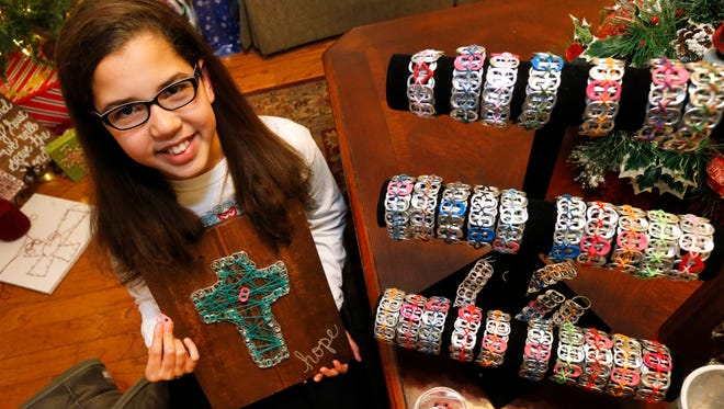 Hannah Nelson, 11, makes bracelets, key chains and string art using soda pop tabs. She raises money for Ronald McDonald House and for research for two rare and debilitating diseases that she has: PHACE syndrome and moyamoya disease.