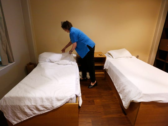 Dr. Janice Landy makes the bed inside of one of the double rooms in the psychiatric unit Wednesday, June 15, 2016, at Broadlawns Medical Center in Des Moines.