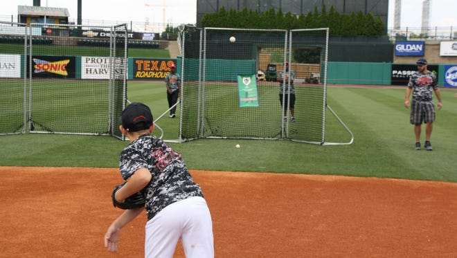 Working on pitching on RBI day at Louisville Slugger Field last year.