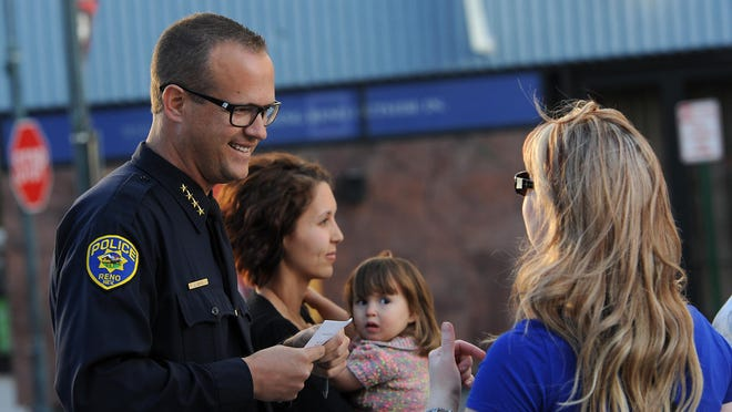Reno Police Chief Jason Soto speaks to people gathered during a ceremony under the Reno Arch in May 2015.