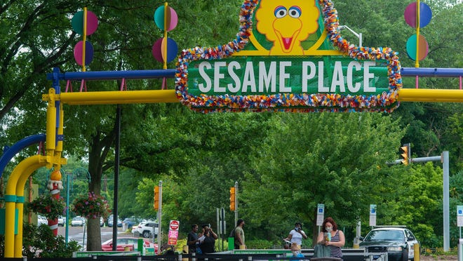 People wearing masks enter on opening day at the park  Friday, July 24, 2020 at Sesame Place in Langhorne. The park normally opens in April, but due to COVID-19, they have finally been allowed by the state of Pennsylvania to open for the season with restrictions.