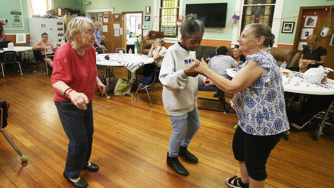 Patrons of the Topeka LULAC Senior Center dance to the tunes of the Chip Cushinberry Blues Duo.