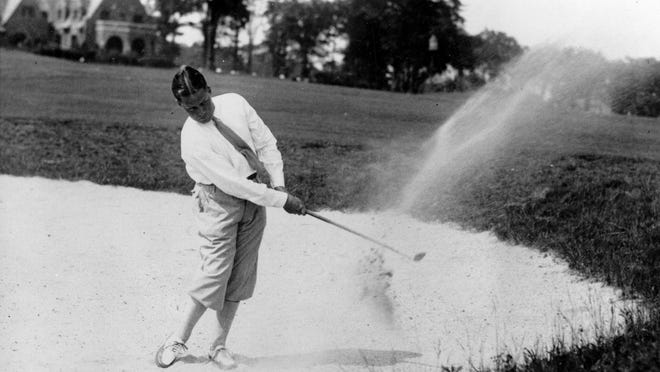 Amateur Bobby Jones is shown making a shot out of a sand trap as the 33rd U.S. Open Golf championship gets underway at the Winged Foot Golf Club at Mamaroneck, N.Y., June 27, 1929. Jones defeated Al Espinosa in playoff with a score of 291.