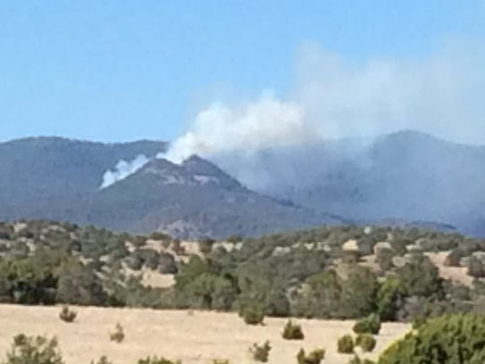 A plume of smoke is seen Sunday afternoon after the