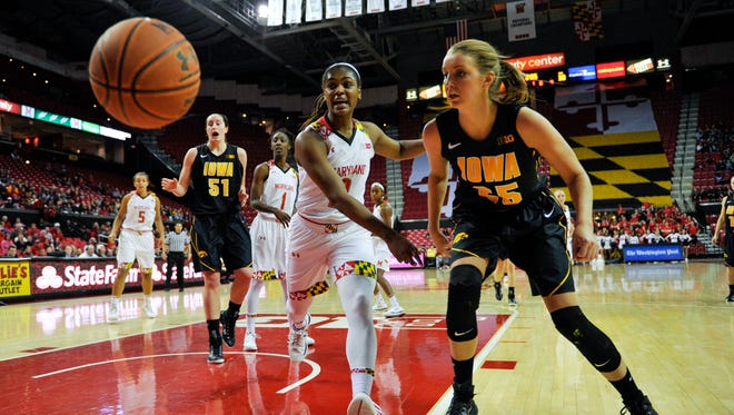 Maryland Terrapins guard Kiara Leslie (2) and Iowa Hawkeyes forward Kali Peschel (25) watch the ball during the first half at Xfinity Center. Fifth-ranked Maryland beat No. 20 Iowa 93-88.