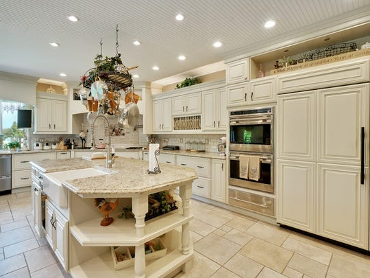 The large kitchen has two islands and two sinks.