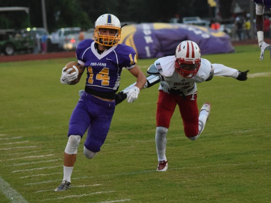 ASH receiver Suede Taylor tries to elude a Tioga defender in last year's game.