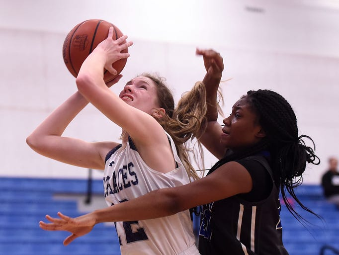 Granville's Isabella Yeager shoots against defense