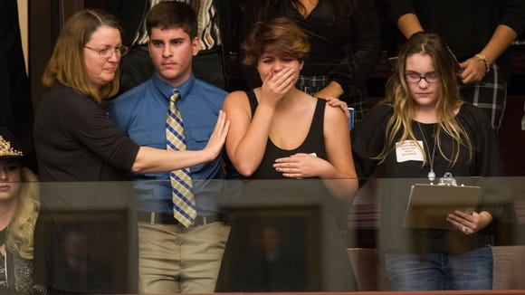 Sheryl Acquarola, a 16-year-old junior from Marjory Stoneman Douglas High School is overcome with emotion in the east gallery of the House of Representatives after the representatives voted not to hear a bill banning assault rifles and large capacity magazines. Acquarola was one of the survivors of the Marjory Stoneman Douglas High School shooting that left 17 dead, who were in Tallahassee on Feb. 20, 2018 to meet with Florida lawmakers. Credit: Mark Wallheiser, AP