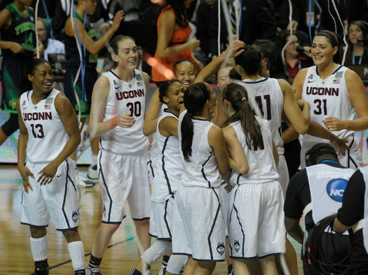 UConn celebrate at the Woman's Final Four at the Bridgestone Arena on Tuesday April 8, 2014, in Nashville in Tenn.
