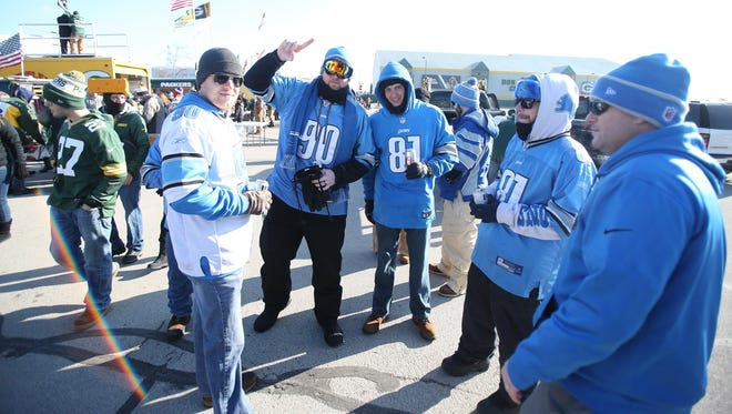Detroit Lions fans hang out before their game against the Green Bay Packers today at Lambeau Field in Green Bay.