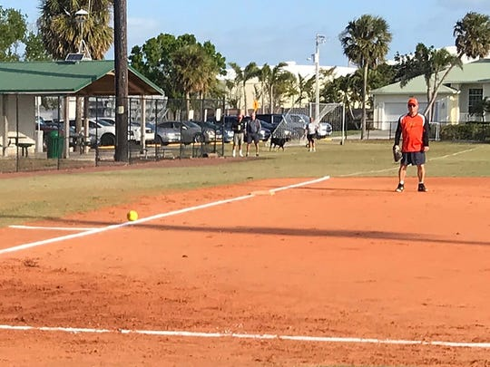 Mike Galatis of Crazy Flamingo's rips the ball down the third base Line in tournament game against CJ's on the Bay.