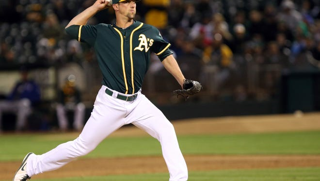 Apr 22, 2014; Oakland, CA, USA; Oakland Athletics relief pitcher Luke Gregerson (44) pitches the ball against the Texas Rangers during the ninth inning at O.co Coliseum. The Texas Rangers defeated the Oakland Athletics 5-4. Mandatory Credit: Kelley L Cox-USA TODAY Sports ORG XMIT: USATSI-165896 ORIG FILE ID:  20140422_ajl_ax5_480.jpg