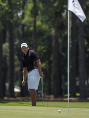 Henry Westmoreland IV watches his ball as it rolls on the green during the Oglethorpe Invitational golf tournament Saturday, July 23, 2016, in Wilmington Island, Ga.