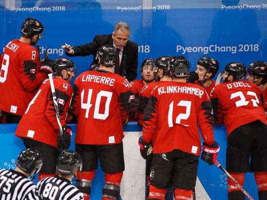 Canada head coach Willie Desjardins talks to his players during the third period of the quarterfinal round of the men's hockey game against Finland at the 2018 Winter Olympics in Gangneung, South Korea, Wednesday, Feb. 21, 2018. (AP Photo/Jae C. Hong)