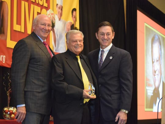 From left, Mark Nickerson, President, College of the Desert Foundation, honoree Harold Matzner and Joel Kinnamon, COD Superintendent/President at the COD Foundation Academic Angels Citizens of Distinction awards luncheon on Thursday, Dec. 10, 2015 at the Renaissance Indian Wells Resort & Spa.