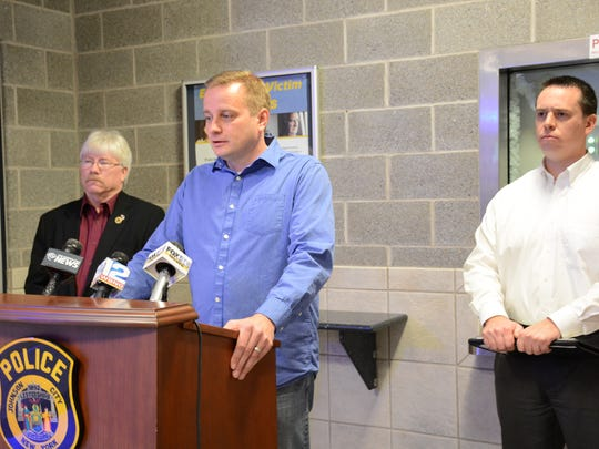 District Attorney Stephen Cornwell, at the podium, speaks during a news conference at Johnson City Police headquarters about a recent shooting.